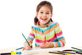 Smiling little girl draw with crayons — Stock Photo