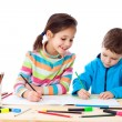 Two little kids draw with crayons — Stock Photo #8777306