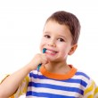 Smiling boy brushing teeth — Stock Photo
