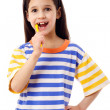 Smiling girl brushing teeth — Stock Photo