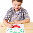 Stock Photo: Little boy draw for mum