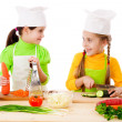 Two girls making salad — Stock Photo