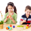 Stock Photo: Two kids painting easter eggs