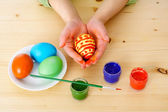 Child's hands with easter eggs — Photo