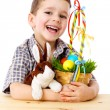 Smiling boy with easter eggs and bunny — Stock Photo #9054400