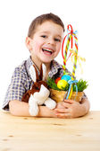 Smiling boy with easter eggs and bunny — Stock Photo