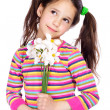 Pensive girl with white daffodils — Stock Photo #9067242