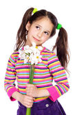 Pensive girl with white daffodils — Stock Photo