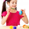 Smiling girl painting easter eggs — Stock Photo
