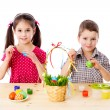 Foto Stock: Two kids painting easter eggs
