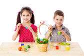 Two kids painting easter eggs — Photo