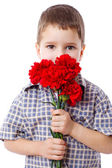 Boy with bouquet of carnations — Stock Photo