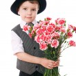 Little boy holds a bouquet of carnations — Stock Photo