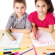 Two smiling kids draw for mum — Stock Photo