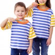 Smiling kids brushing teeth together — Stock Photo #9356342