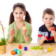 Two kids showing painted easter eggs — Stock Photo #9356368