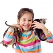 Happy little girl cuddle two kitten — Stock Photo
