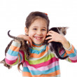 Happy little girl cuddle two kitten — Stockfoto