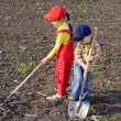 Two kids with garden tools — Stock Photo