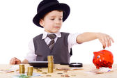 Boy at the table counts money — Stock Photo