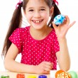 Happy girl showing painted easter egg — Stock Photo #9539248
