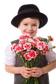 Happy boy with a bouquet of carnations — Stock Photo