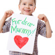 Stock Photo: Little boy holding a drawing for mum