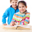 Two kids reading the book together — Stock Photo