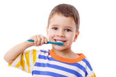 Cute little boy brushing teeth — Stock Photo