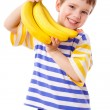 Happy boy holds a bunch of bananas — Stock Photo