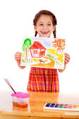 Smiling little girl with watercolor painting — Stock Photo
