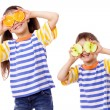 Two funny kids with fruits on face — Stock Photo #9758527