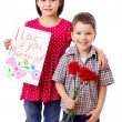 Two kids with greetings for mum — Stock Photo #9816790