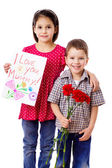 Two kids with greetings for mum — Stock Photo