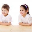 Two smiling kids at the desk — Stock Photo #9855022