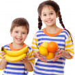 Happy kids holds a tropical fruits — Stock Photo