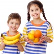 Happy kids holds a tropical fruits — Stock Photo #9855025