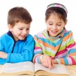 Two kids reading the book — Stock Photo #9960215