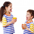 Two funny kids with juice — Stock Photo #9960226