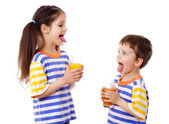 Two funny kids with juice — Stock Photo