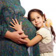 Girl with his pregnant mother — Stock Photo