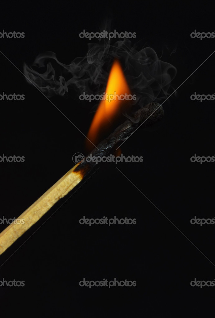 Burning match on black background — Stock Photo #8513253