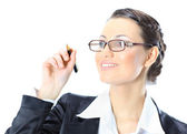 Nice business woman in glasses wrote pen in the air. Isolated on a white background. — Stockfoto