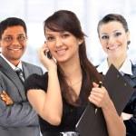 Office an interracial team of seven — Stock Photo
