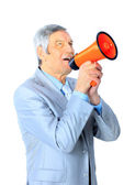 Nice businessman at the age, shouts through the speaking-trumpet. Isolated on a white background. — Stock Photo