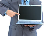 The young businessman keeps the laptop. Isolated on a white background. — Stock Photo