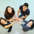 Group of with hands together showing teamwork — Stock Photo #10374063