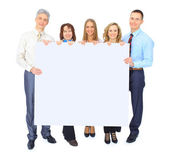 Group of business holding a banner ad isolated on white — Stock Photo