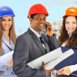 Stock Photo: A man and woman architect team on construction site