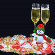 Glasses of champagne with snowmen, decorated, on a black background — Stock Photo